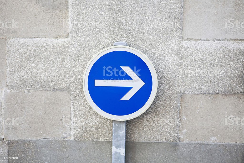 One way sign against limestone wall royalty-free stock photo
