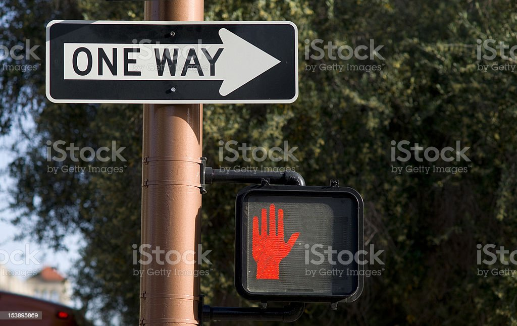 One Way Sign On Downtown Street Corner Don't Walk stock photo