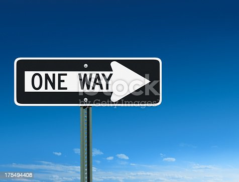 A one way sign over a sky background pointing to the right.