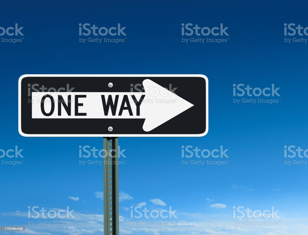 One Way Sign Post Pointing Right Over a Sky Background stock photo
