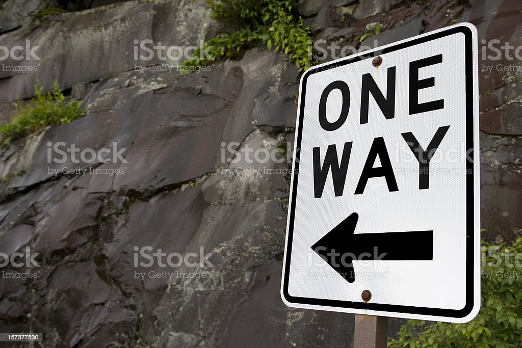 One way sign with rock wall (XXL) royalty-free stock photo