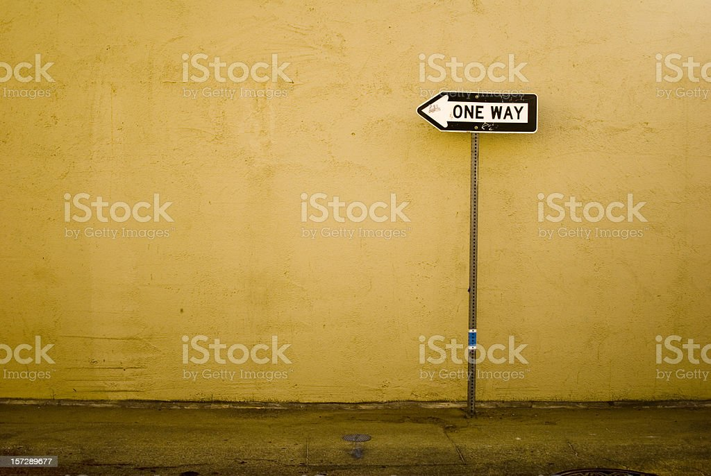 One way to the wall stock photo
