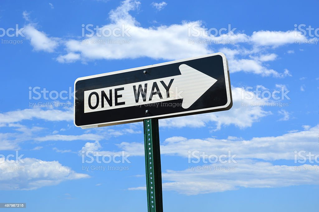 One Way Traffic Signs blue Sky Clouds stock photo