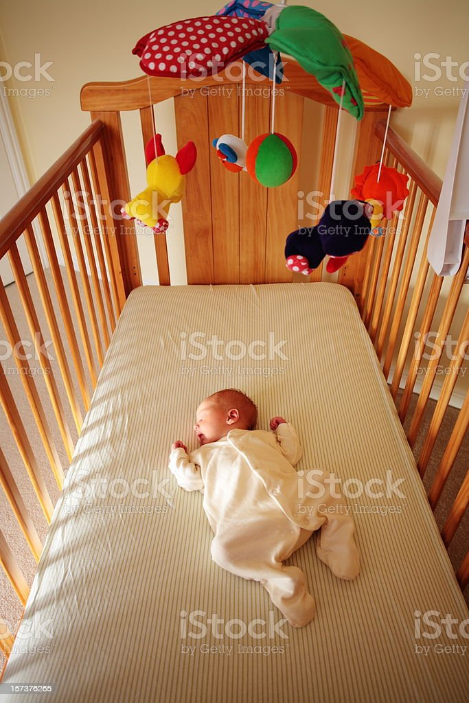 One Week Old Baby Boy in Cot stock photo