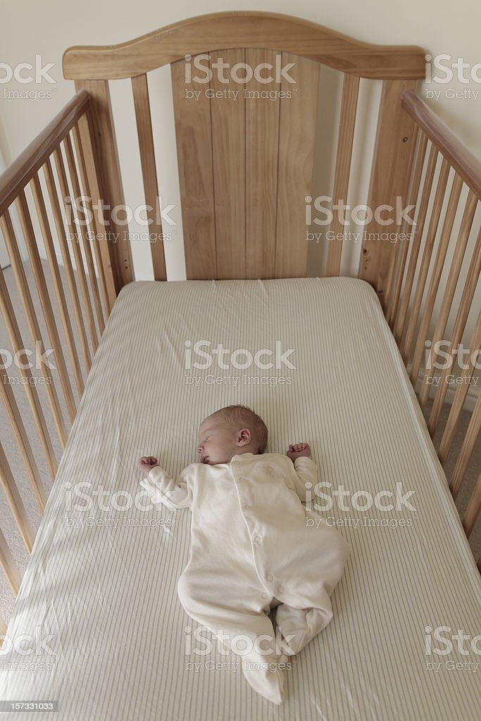 One Week Old Baby in Cot stock photo