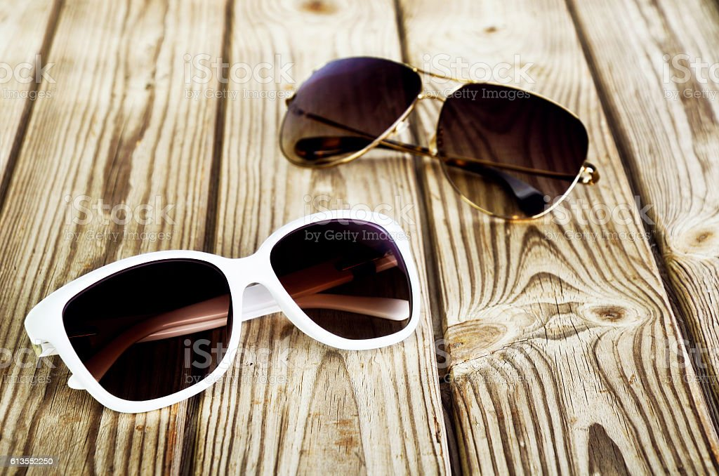 one white female sunglasses and one unisex sunglasses close-up o stock photo