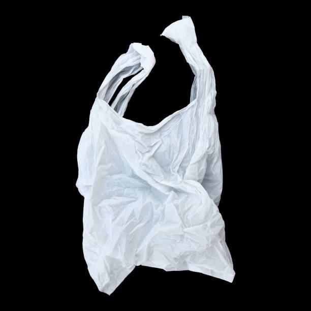 un sac de plastique blanc, isolé sur fond noir - sac en plastique photos et images de collection