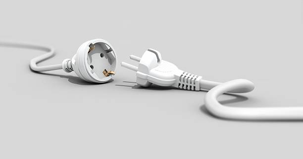 One white plug unplugged from another white plug stock photo