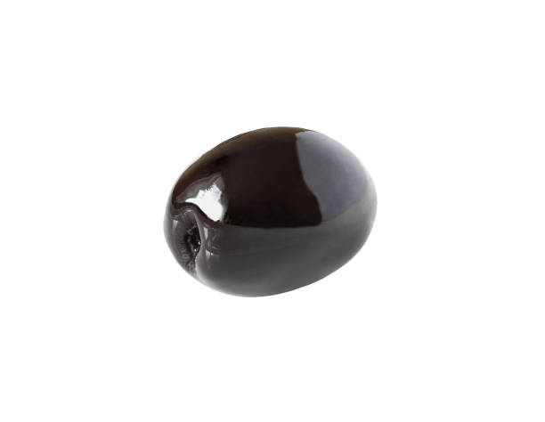 one whole black olive isolated on white with clipping path​​​ foto