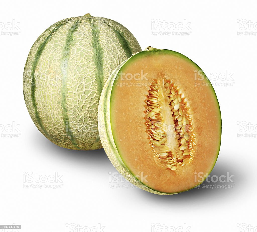 One whole cantaloupe and one half stock photo