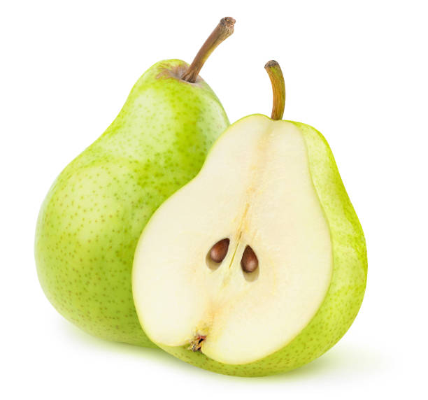 One whole green pear and a half isolated on white background stock photo