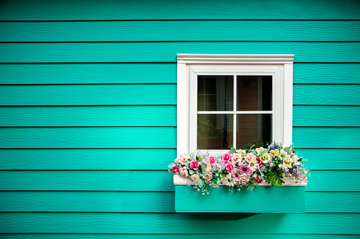 One window of wooden house, Decorated With Fresh Flowers