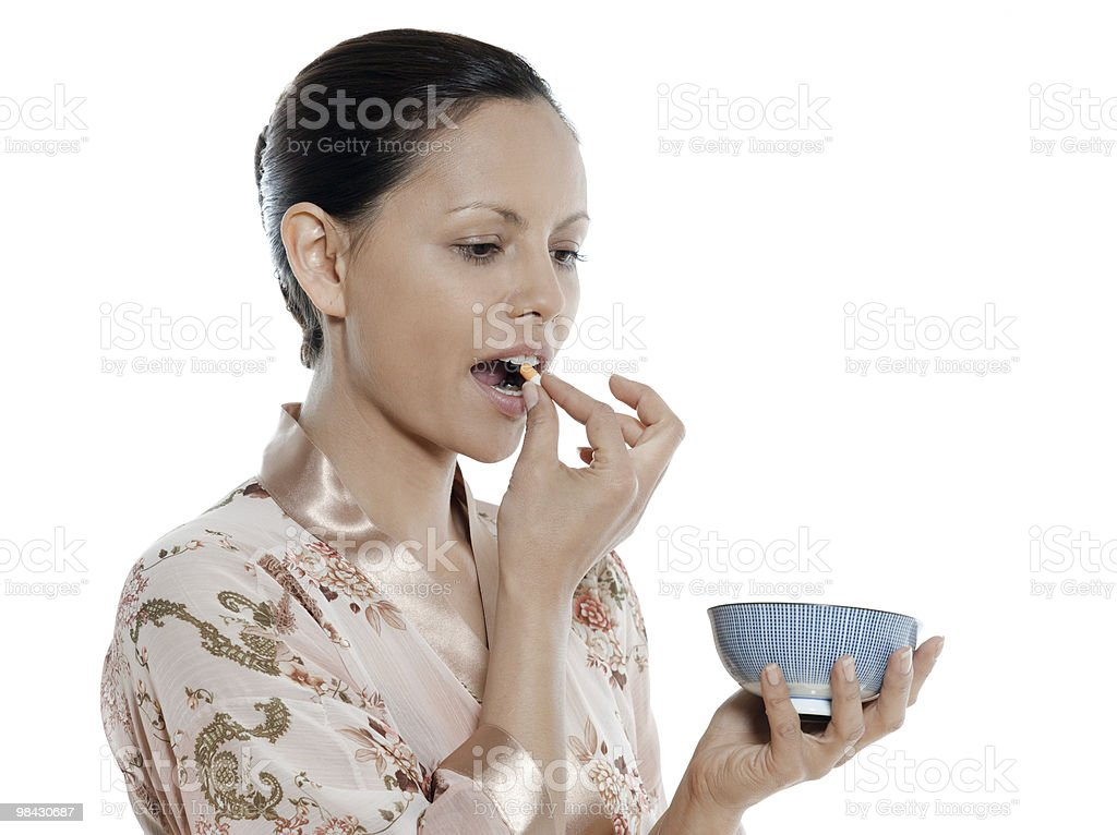 one woman asian taking pill royalty-free stock photo