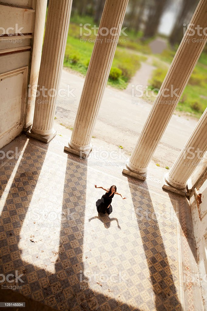 One woman dance in an old palace on the floor royalty-free stock photo