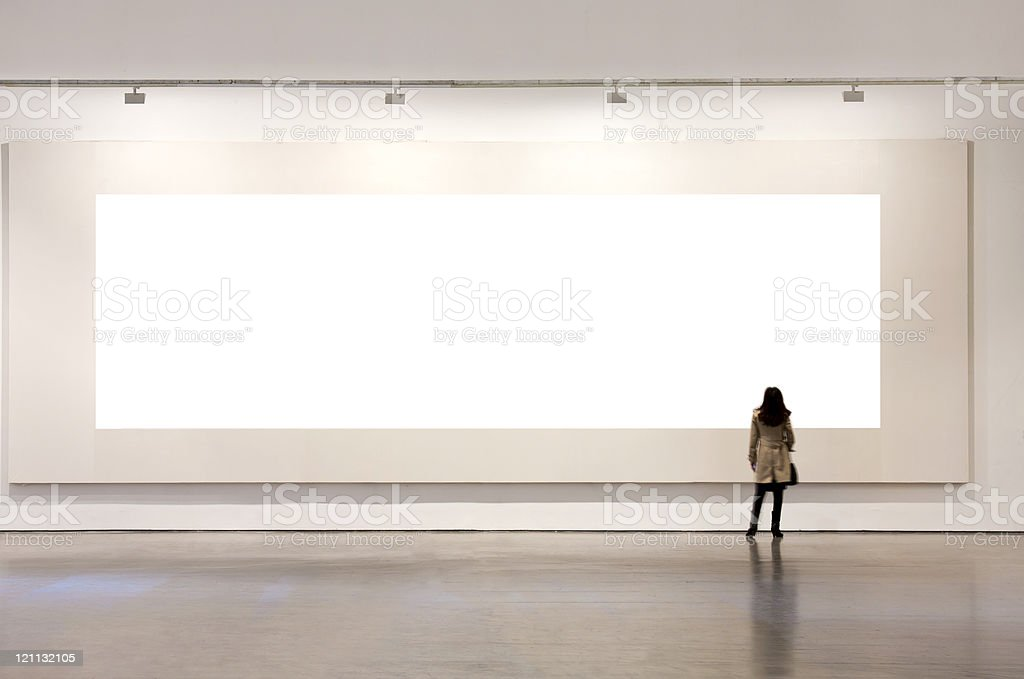 One Woman Looking At White Frame In An Art Gallery Stock Photo ...