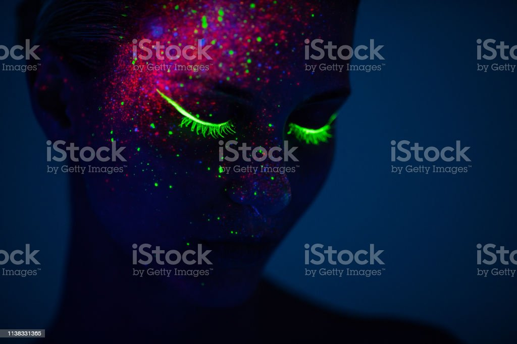 One woman painted with fluorescent make up - Foto stock royalty-free di Adulto