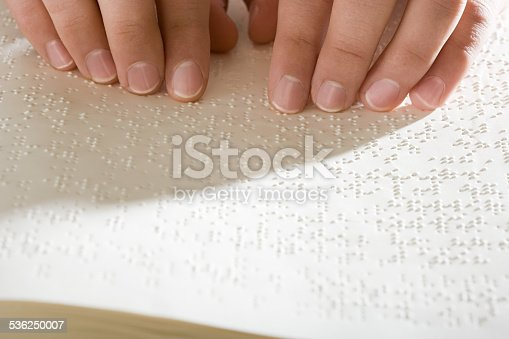 1017945546 istock photo One woman reading braille 536250007