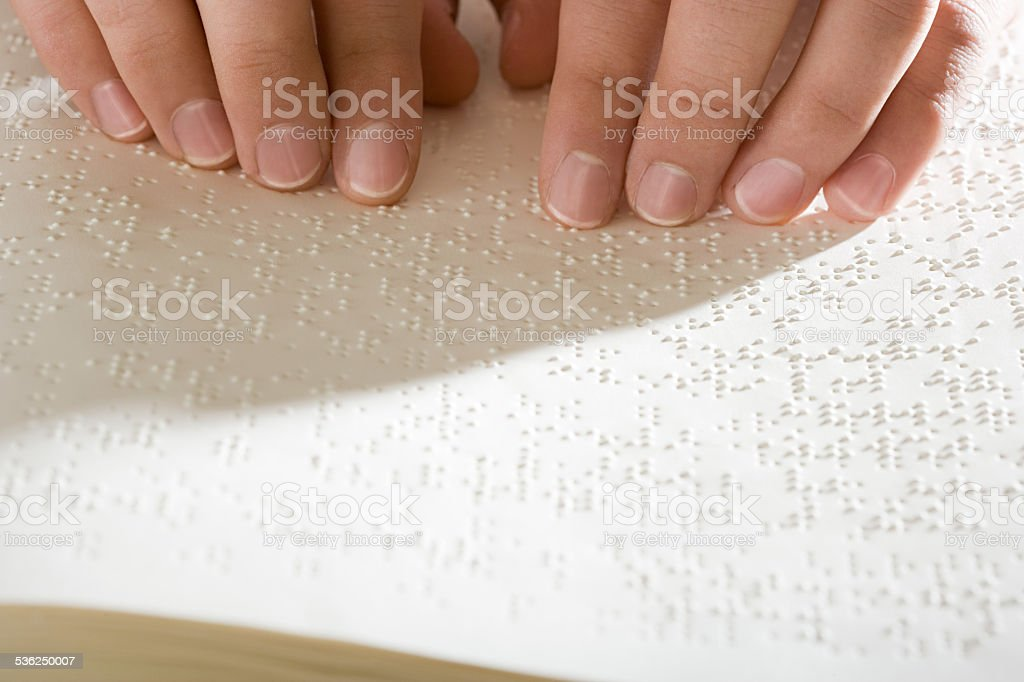 One woman reading braille stock photo
