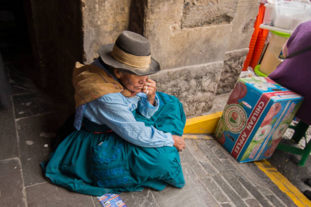 One woman street vendor sitting on the floor during the celebration of the Palm Sunday of Easter in the streets of Ayacucho, stock photo
