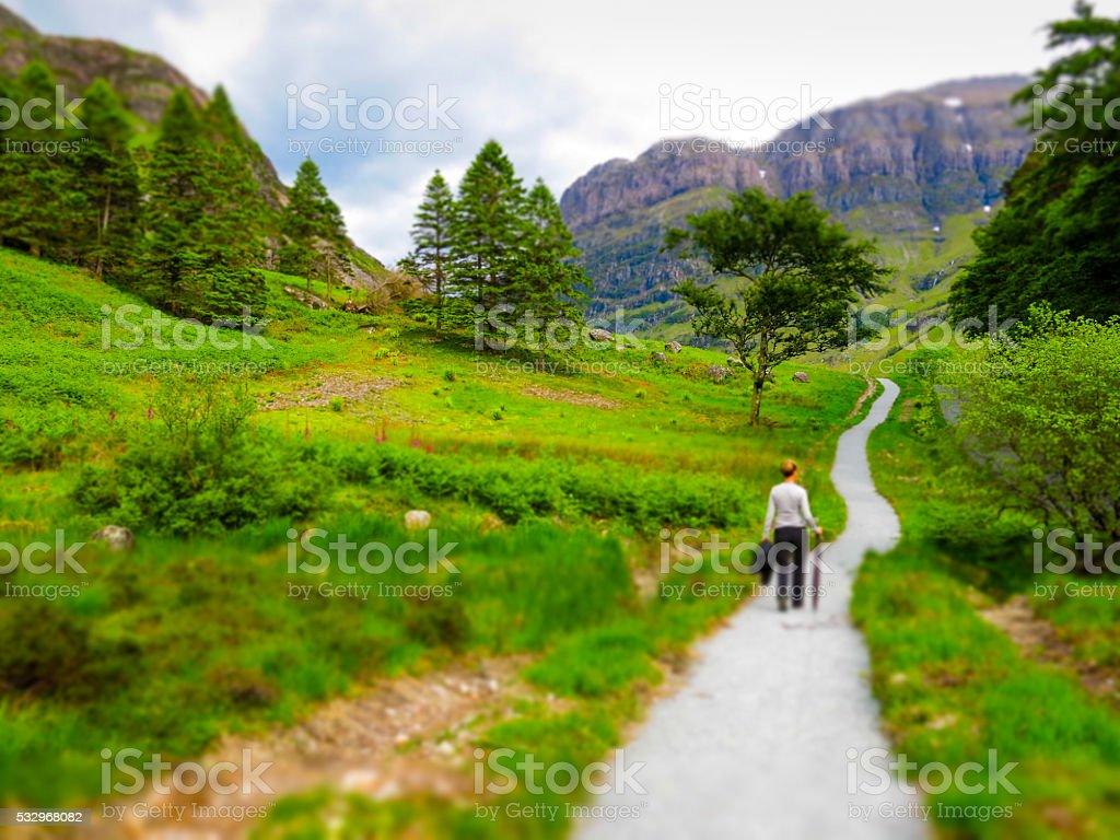 One Woman Walking on Path Glencoe, Scotland stock photo