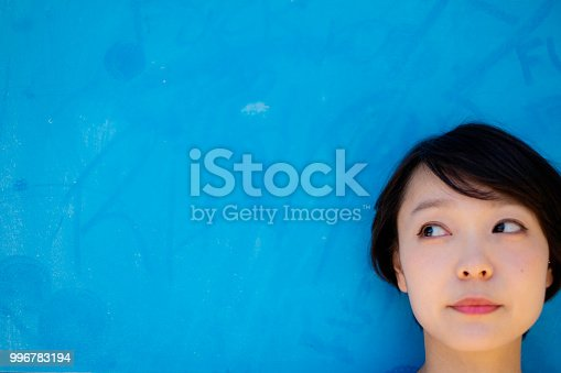 867955978 istock photo One woman who travels the streets of the American atmosphere of Okinawa. 996783194
