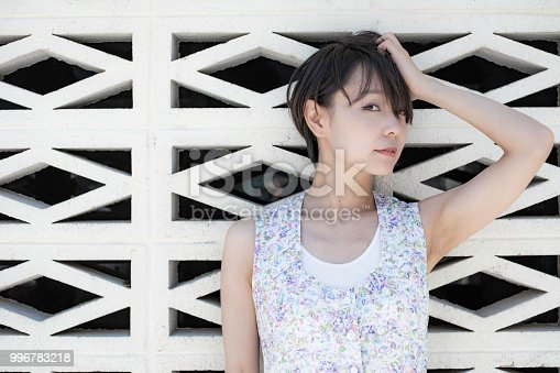 867955978 istock photo One woman who travels the streets of the American atmosphere of Okinawa. 996783218