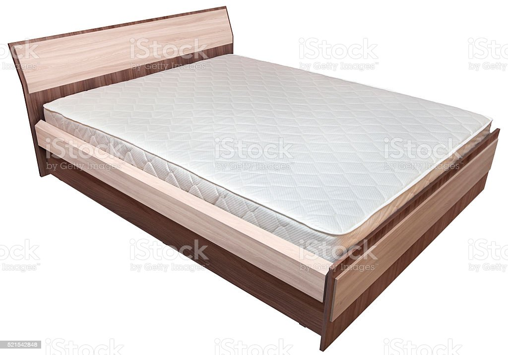 One wooden king size bedstead  with  innerspring mattress, on white. stock photo