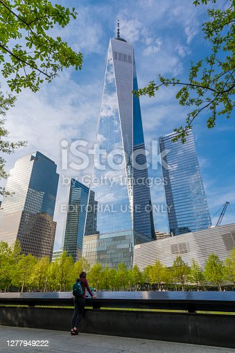 New York, USA - May 11, 2018: View of One World Trade Center from the National September 11 Memorial in New York. It is the main building of the rebuilt World Trade Center complex in Lower Manhattan.
