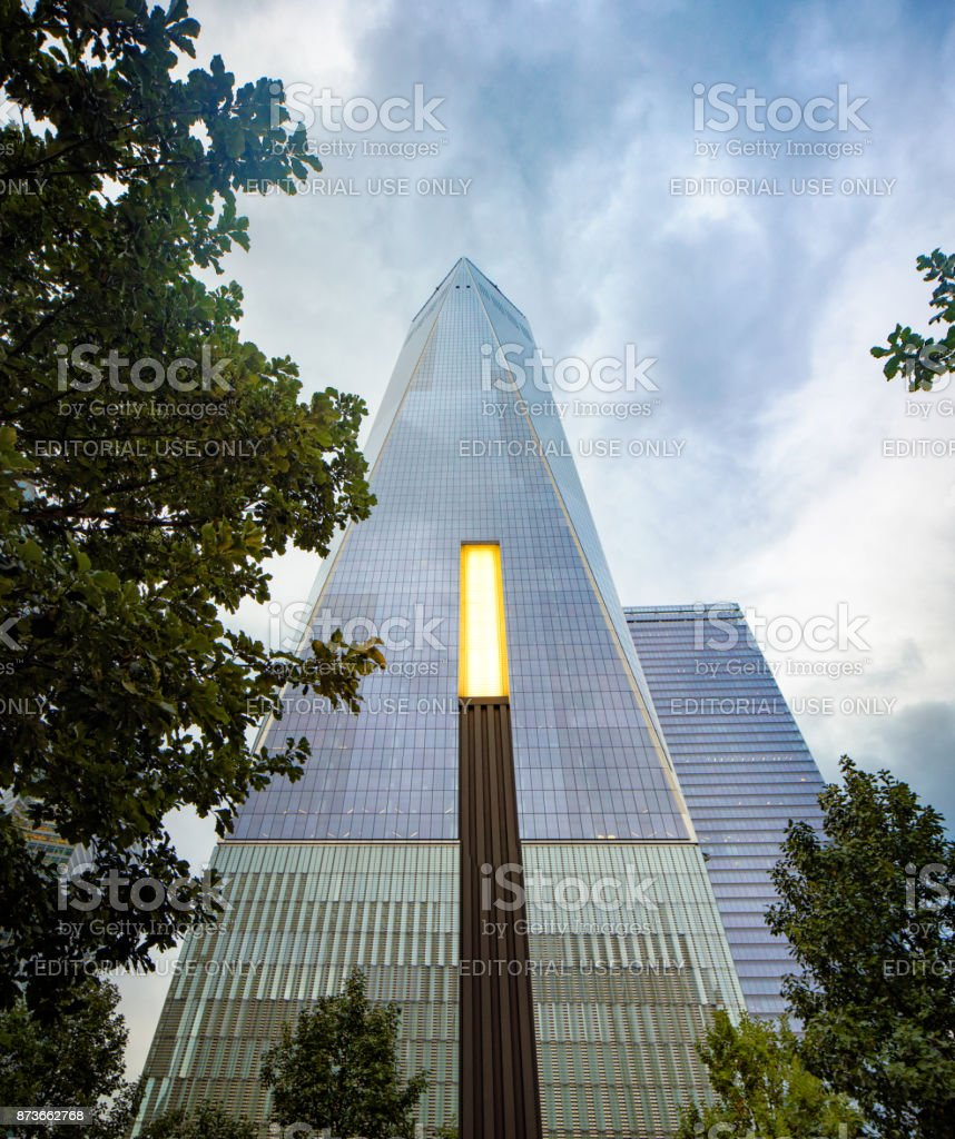 One world trade center building with park light on a cloudy late afternoon stock photo