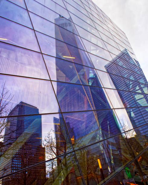 One World Trade Center skyscraper reflected in a glass building stock photo
