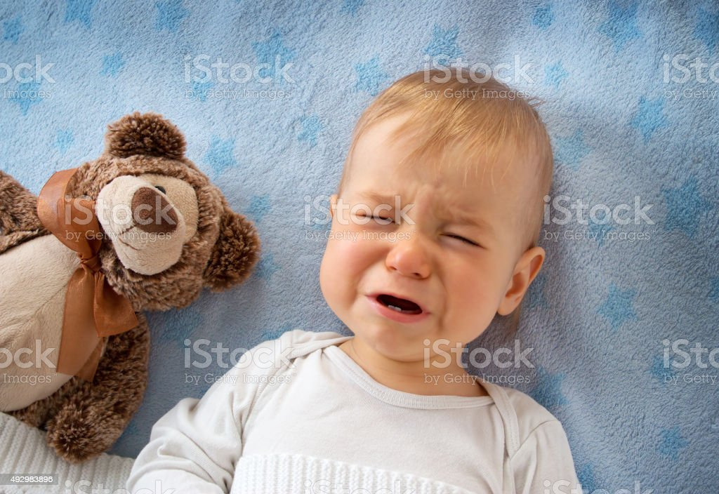 One year old baby crying stock photo