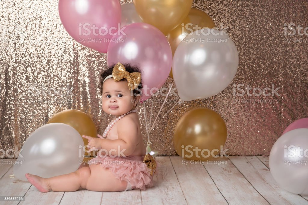 One Year Old Baby Girl with Balloons stock photo