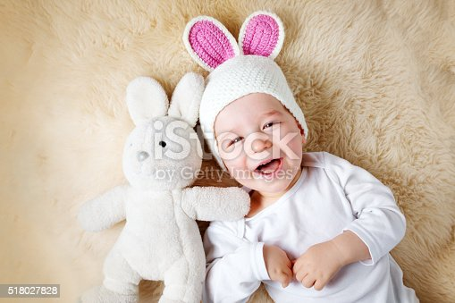 istock one year old baby lying in bunny hat on lamb 518027828