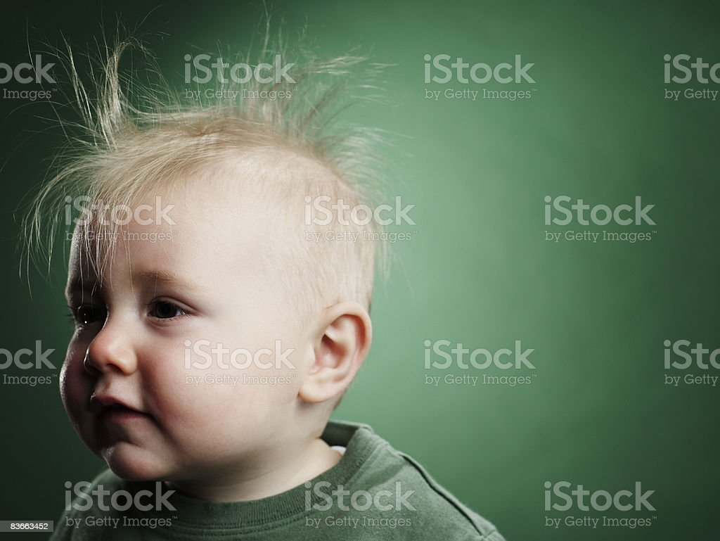 One year old boy with hair sticking up.  royalty free stockfoto