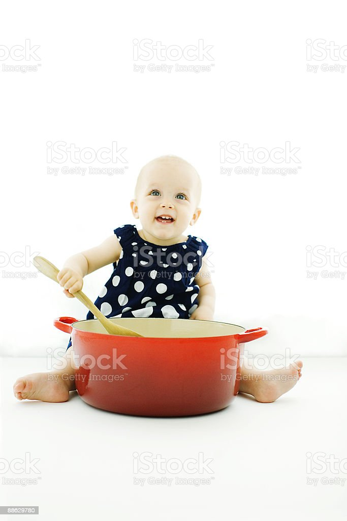One Year Old Girl Playing with Big Red Pot royalty-free stock photo