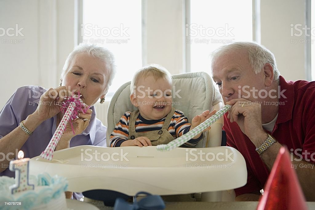 One year old with grandparents stock photo