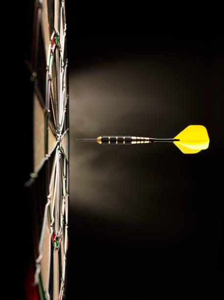 One Yellow Dart on Target stock photo
