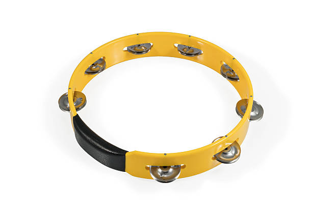 One yellow tambourine isolated Yellow round plastic tambourine with metal plates isolated on white background nicoya peninsula stock pictures, royalty-free photos & images
