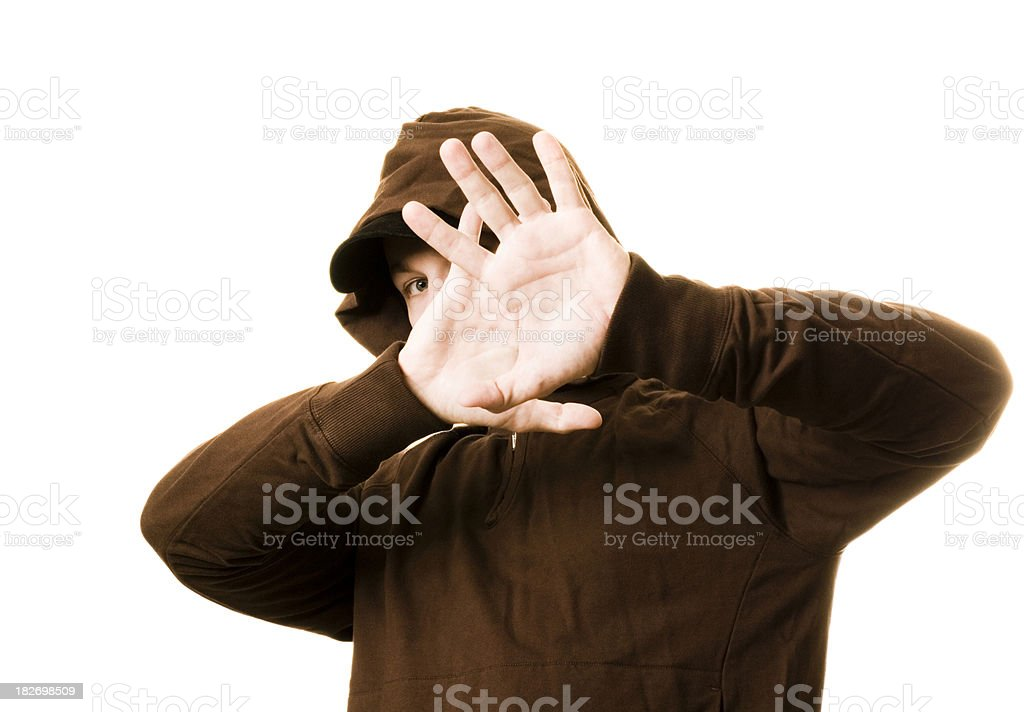 One young adult male hands in front of face royalty-free stock photo