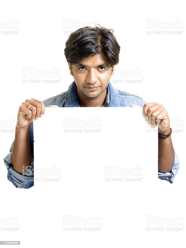 One Young Attractive Indian Adult Man Holding a White Placard royalty-free stock photo