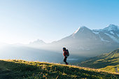 istock One young female hiker walks up hill 1065044056