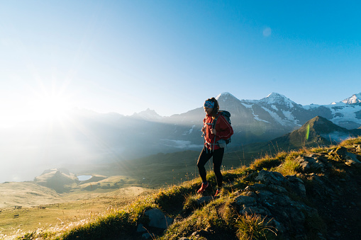 One young female hiker walks up hill