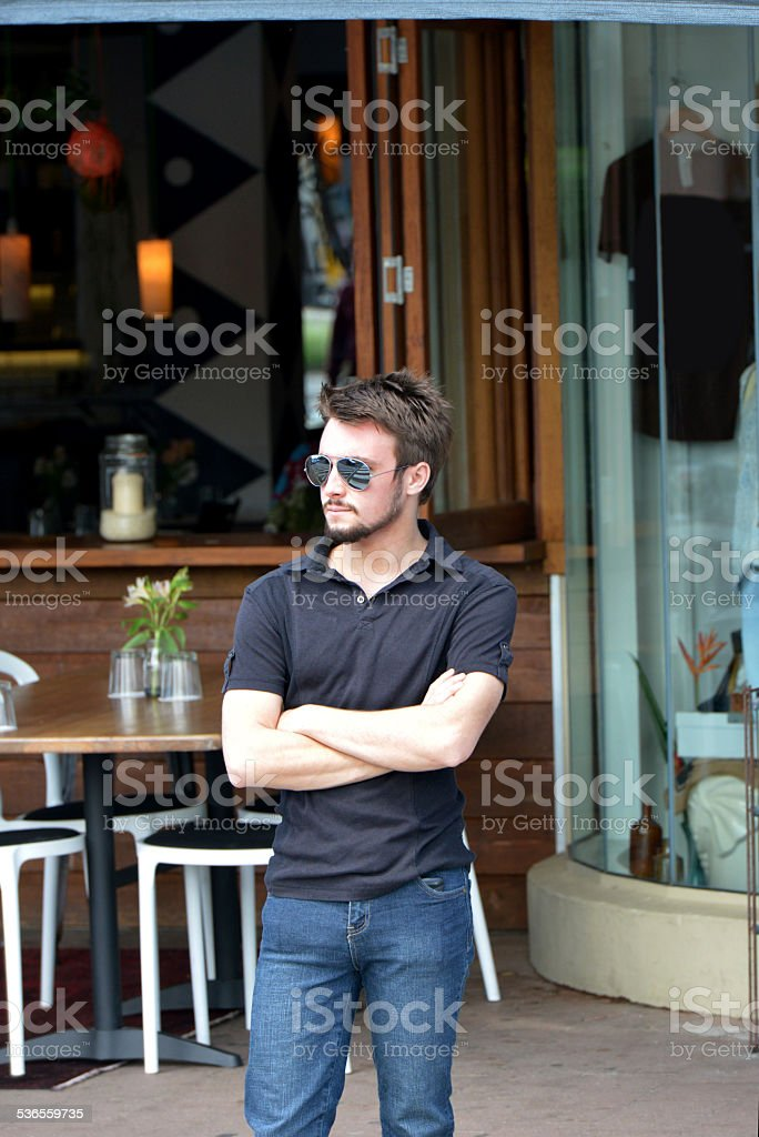 One young guy in the street waiting stock photo