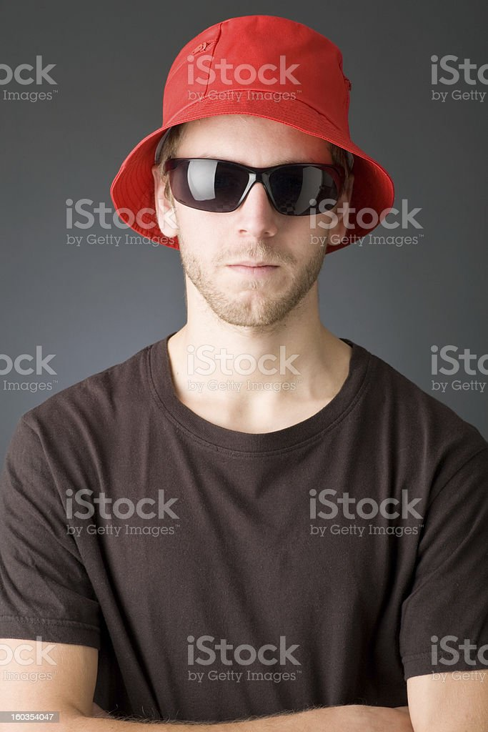 One young man in red hat and sunglasses _ Vertical. royalty-free stock photo