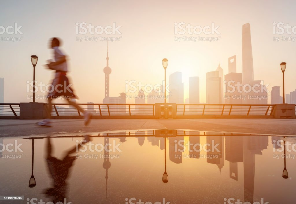 One young man running in the bund stock photo