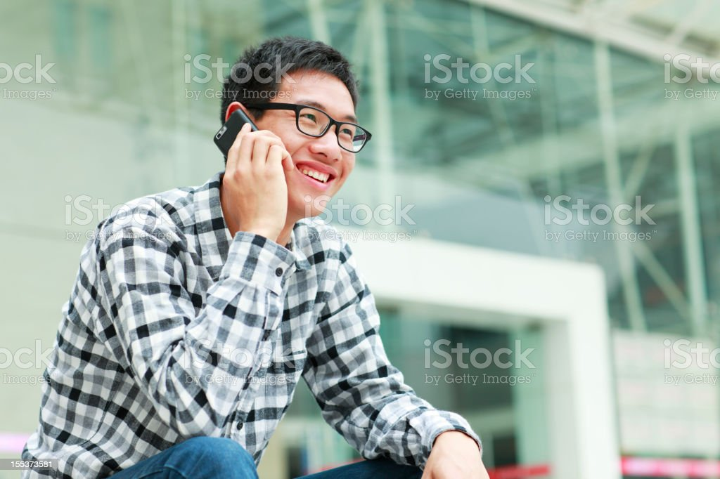 one young man using mobile phone royalty-free stock photo