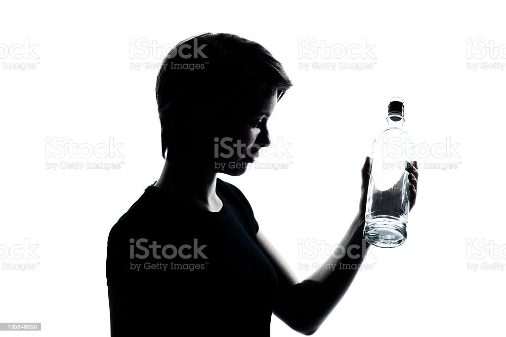 one young teenager boy girl holding empty vodka alcohol bottle stock photo