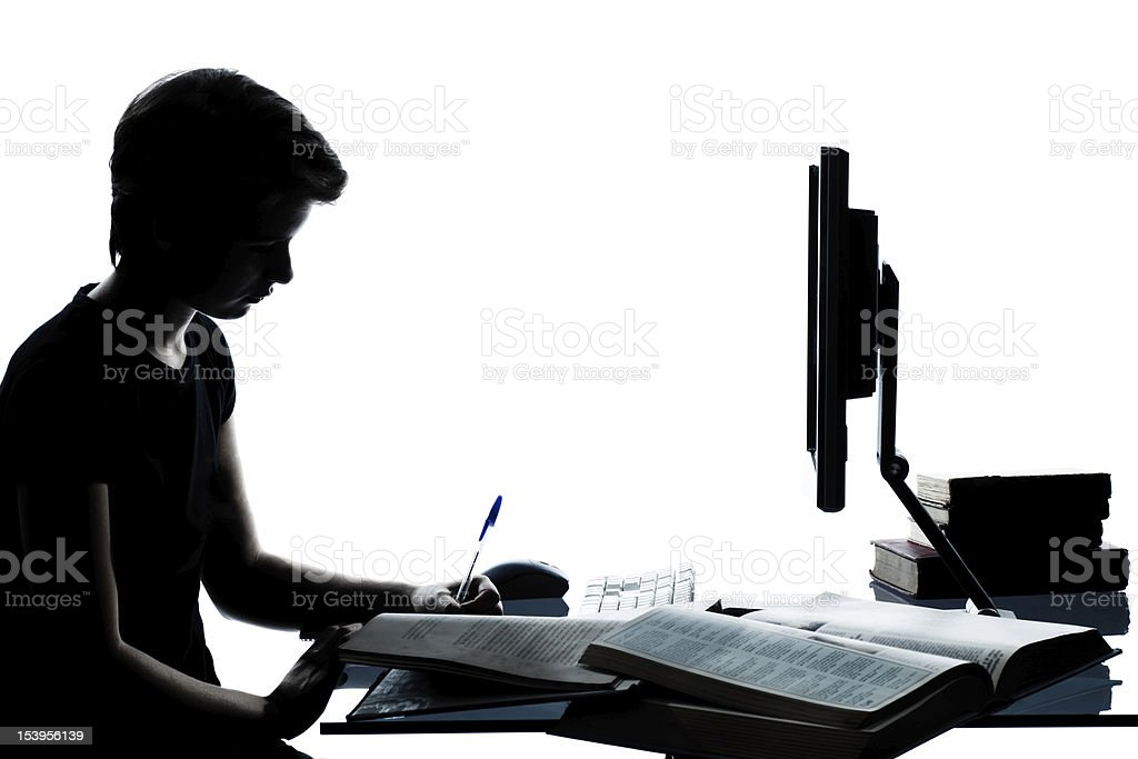 one young teenager boy  girl silhouette studying with computer c stock photo