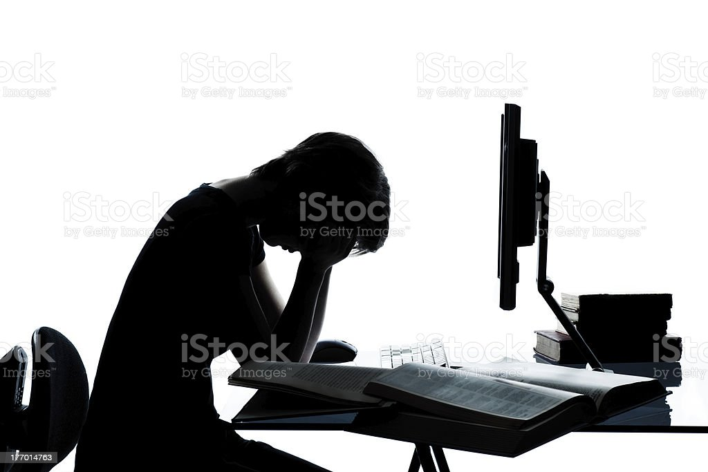 one young teenager boy  girl silhouette studying with computer c royalty-free stock photo