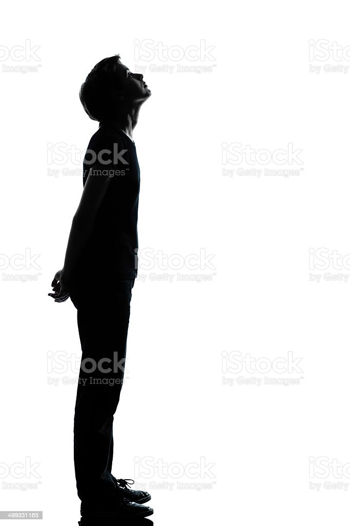 one young teenager boy or girl silhouette stock photo
